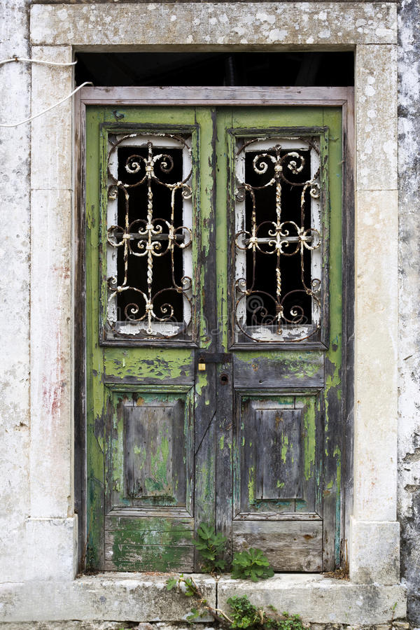 Weathered door, Corfu, Greece. Closed green house entrance door, extremely weathered, Corfu, Greece royalty free stock photography