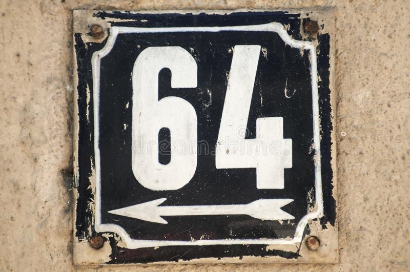 Weathered enameled plate number 64 stock images