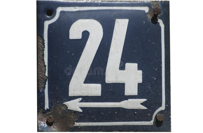 Weathered enameled plate number 24. Weathered grunge square metal enameled plate of number of street address with number 24 closeup isolated on white background royalty free stock photos
