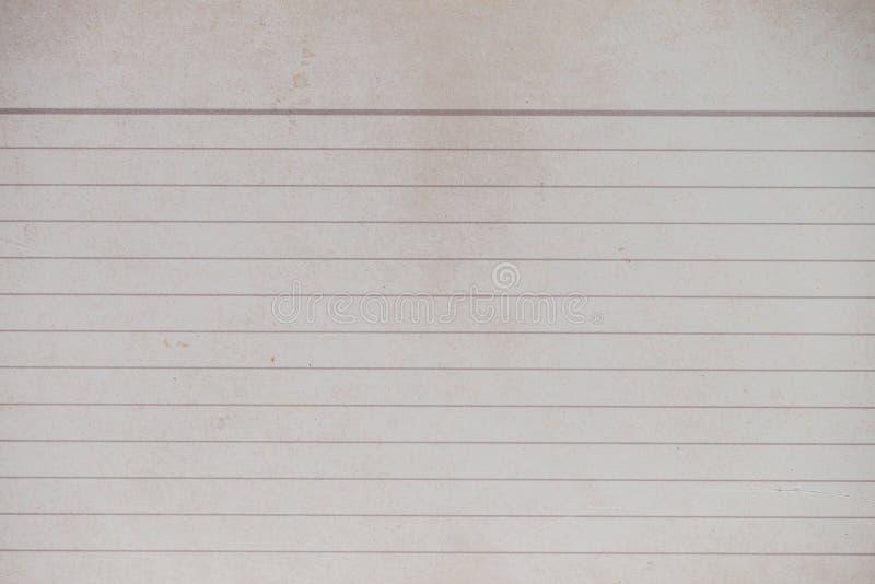 Weathered fodrade papper som kopieringsutrymmebackgorund arkivbild