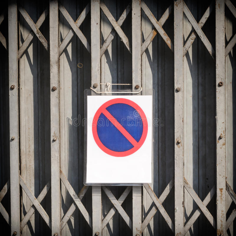 Weathered garage door with no parking sign.  royalty free stock photos