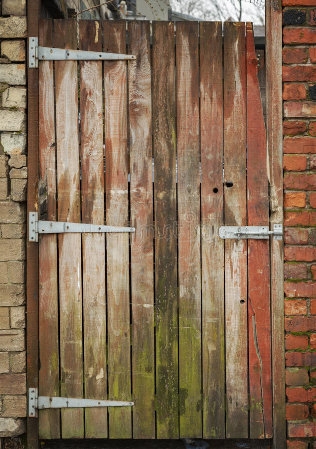 Weathered garden gate. Image of old weathered wooden garden gate stock photos