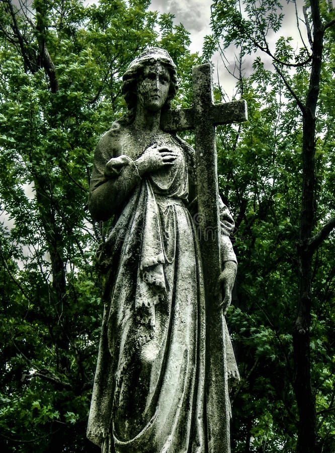Weathered Graveside Statue stock image