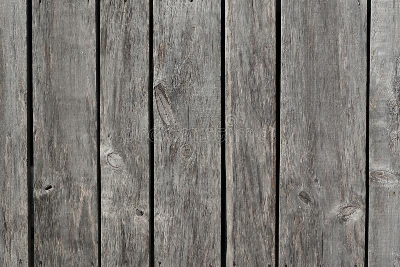 Weathered gray raw wood boards background wallpaper royalty free stock photography