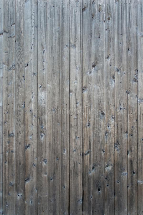 Weathered gray raw wood boards background wallpaper stock image