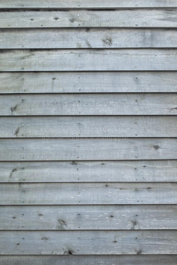 Weathered gray raw wood boards background wallpaper royalty free stock photo