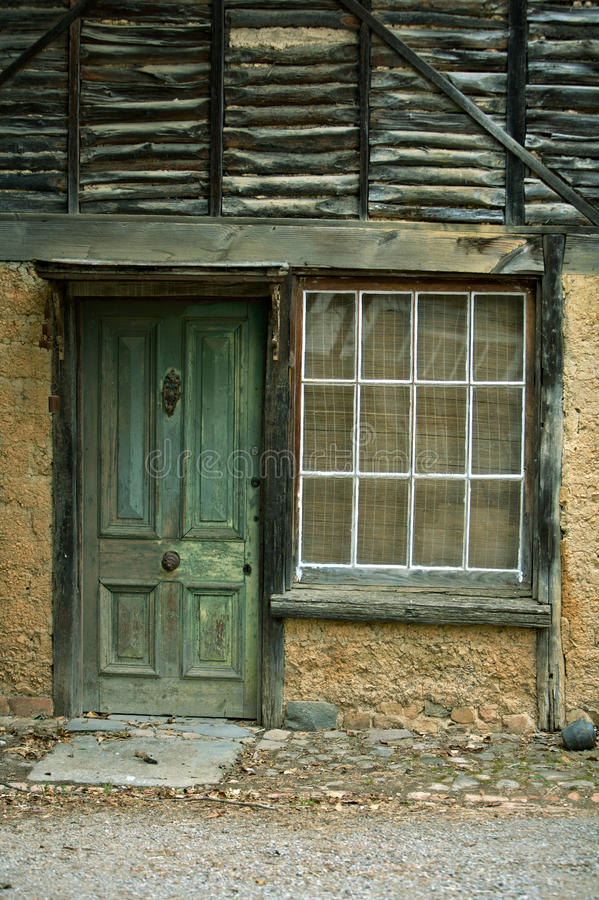 Free Weathered Green Door With An Aged House Royalty Free Stock Image - 11121776