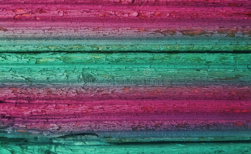 Weathered grunge wooden planks texture background colored in magenta and teal colors stock photos