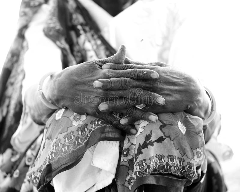 Weathered hands of African woman stock photos