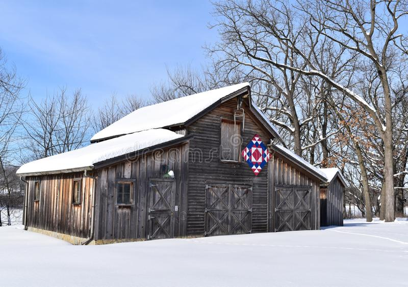 Rustic barn with Amish quilt on a winter day royalty free stock image