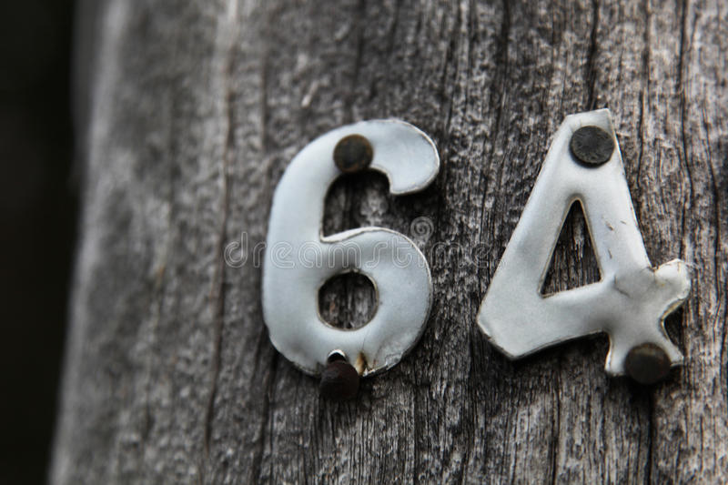 Metal numbers 64 royalty free stock photos