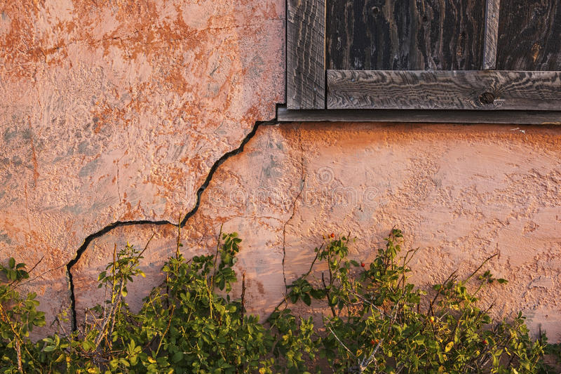 Old stucco house with cracked wall stock photography