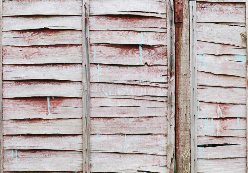 Weathered painted brown fence background stock photo