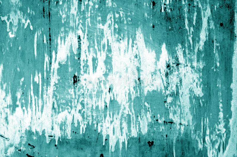 Weathered painted metal wall in cyan color. Abstract background and texture stock images