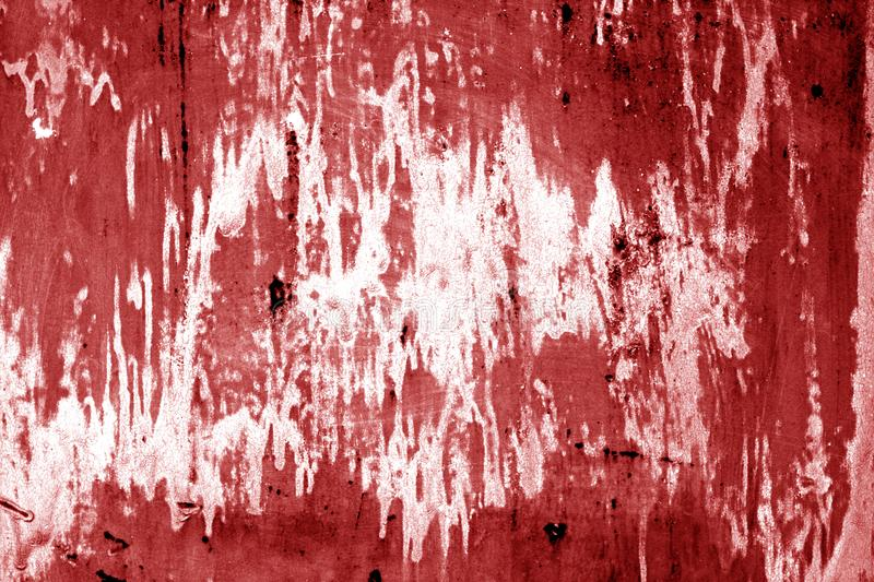 Weathered painted metal wall in red color. Abstract background and texture royalty free stock photography