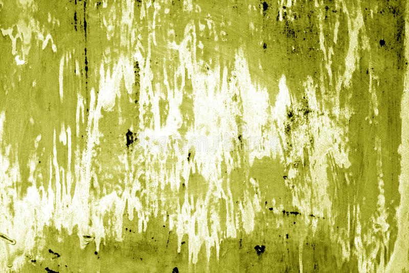 Weathered painted metal wall in yellow color. Abstract background and texture stock images