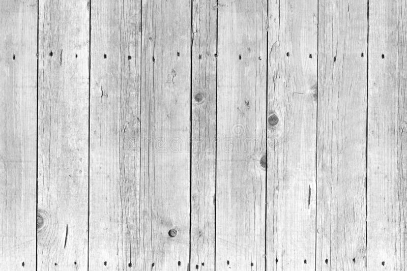 Weathered Pallet - Wooden Texture Background. Tabletop view of  nailed up and weathered wooden pallet boards in vertical orientation - as wooden background stock image