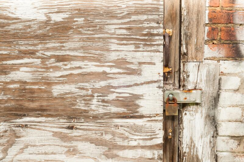 Weathered plywood and rusty lock stock photography