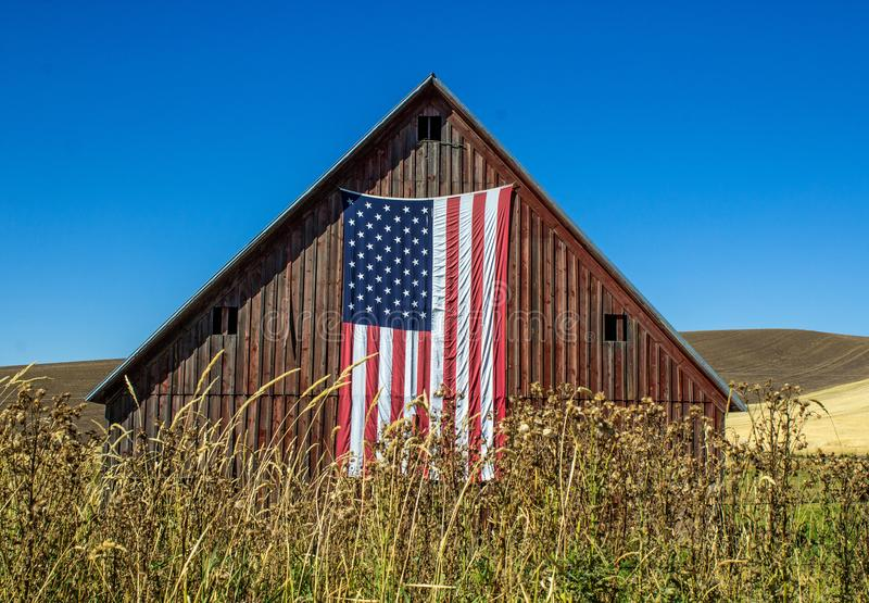 Weathered Red Barn with American Flag royalty free stock image
