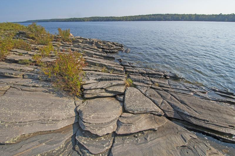 Weathered Rocks and Water on the Great Lakes Shore. In Lake Huron in KillBear Provincial Park in Ontario stock photos