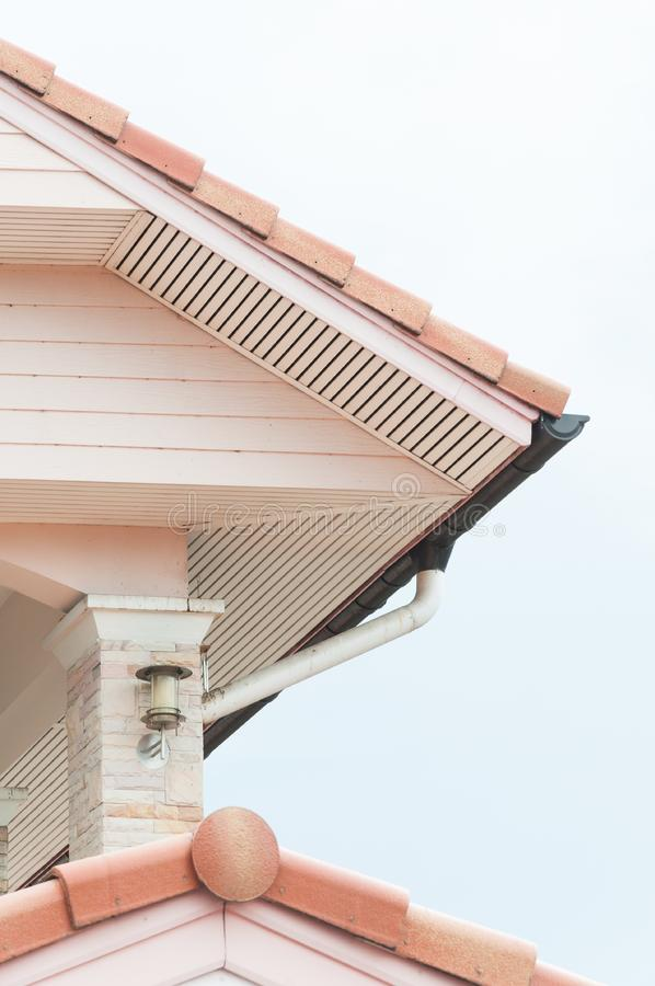 Weathered roof with rain gutter of roof top house royalty free stock image