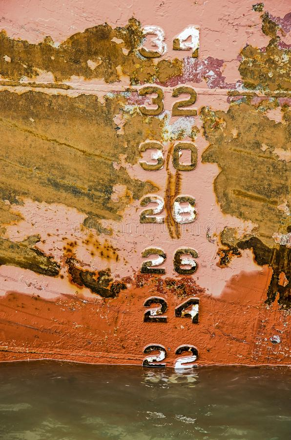 Draught numbers on a rusty ship`s hull royalty free stock photo