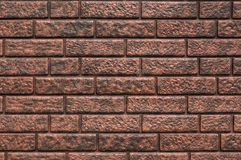 Weathered texture of stained old dark brown and red brick wall background, grungy rusty blocks of stone-work technology, colorful stock image