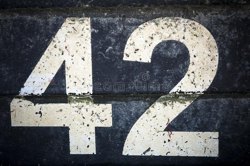 Number forty two in bold figures on black background stock image