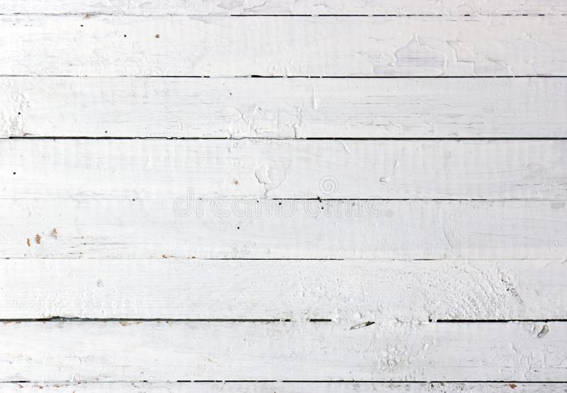 Weathered white wood. A background of weathered white painted wood