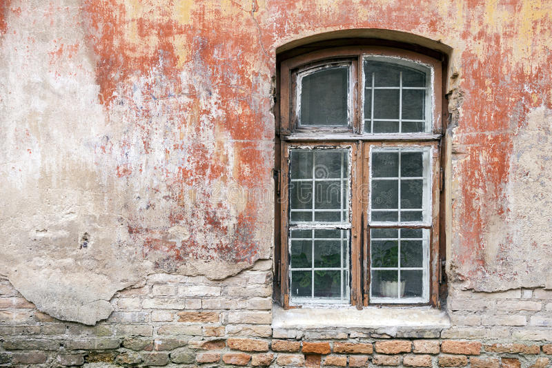 Weathered window and old shabby building wall royalty free stock images