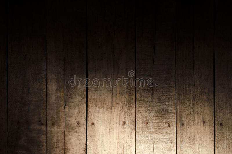 Weathered wood background. Aged wood slat wall in shadow illuminated from the bottom stock photos