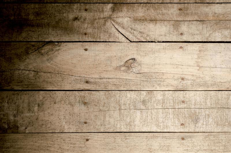 Weathered wood background. Aged wood slat wall in shadow illuminated from the right side stock images
