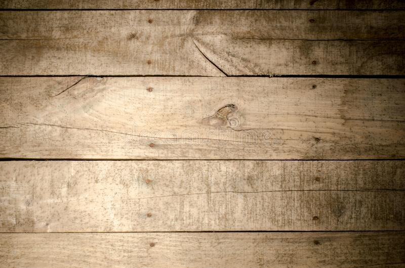 Weathered wood background. Aged wood slat wall illuminated from the left side with the right side in shadow stock photo