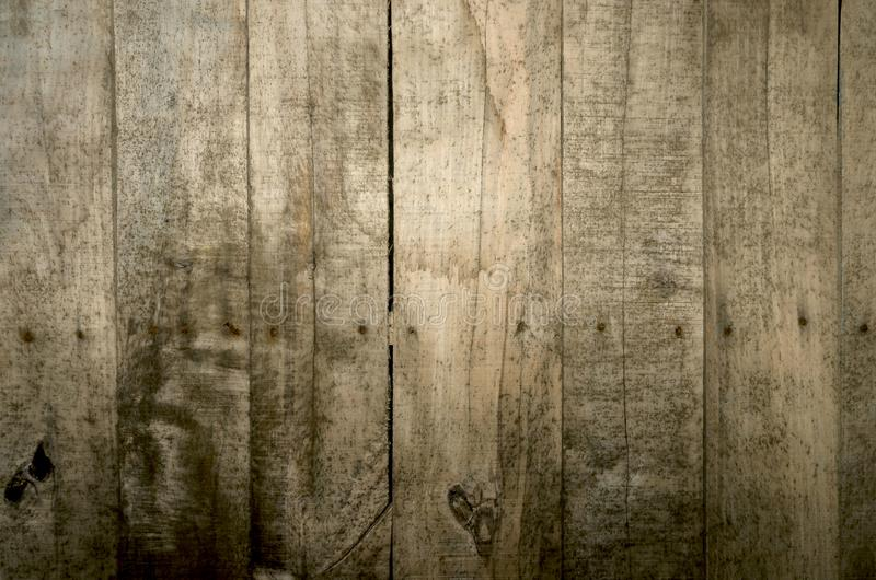 Weathered wood background. Aged wood slat wall in shadow illuminated from the top royalty free stock photography