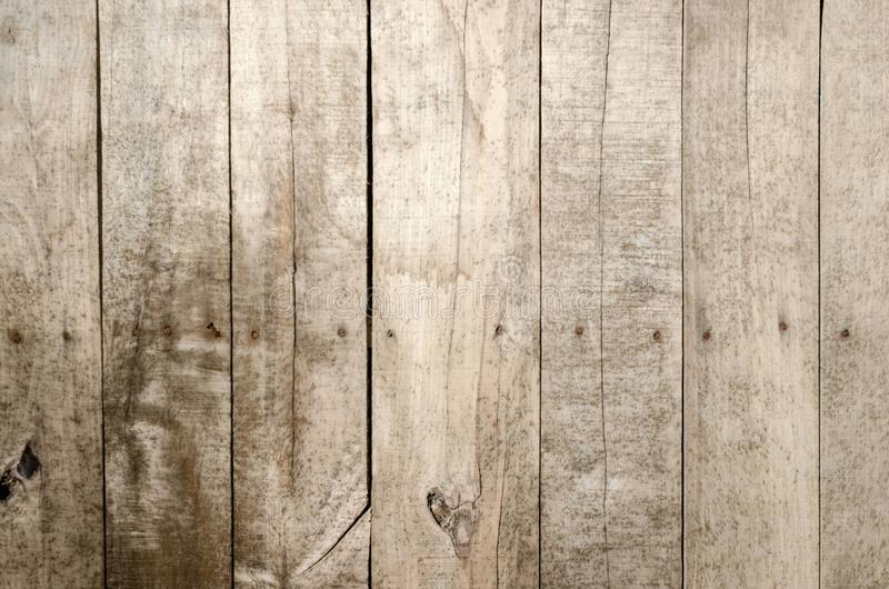 Weathered wood background. Aged wood slat wall in shadow illuminated from the top stock image