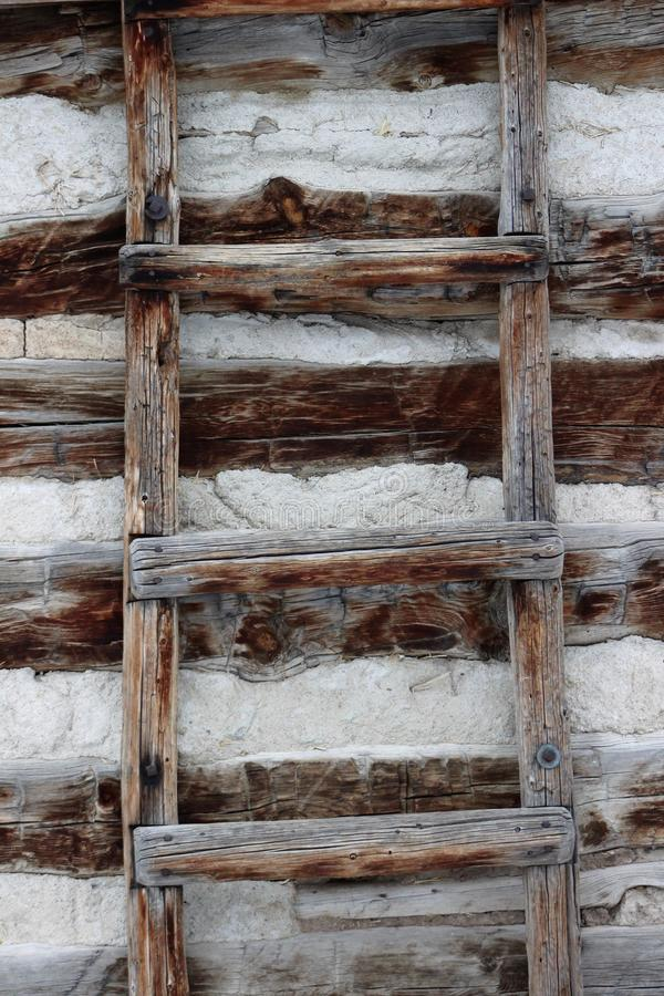 Rustic weathered primitive wood ladder royalty free stock photo