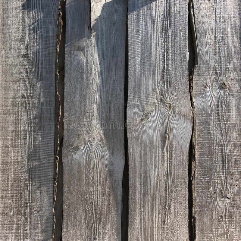 Weathered wood. Rough distressed weathered wood boards texture close-up stock photo