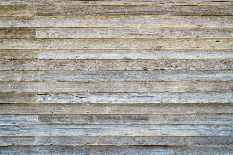 Weathered wood siding of abandoned farm house royalty free stock images