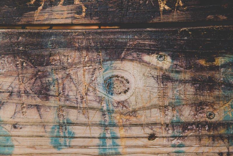 Weathered Wood Texture Graffiti Background. A weathered wood background with burnt parts, scratches, graffiti, etc stock photography