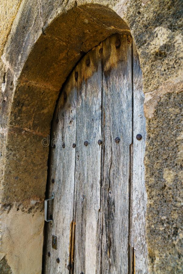 Weathered wooden door with rustic wood grain - angled view royalty free stock photo