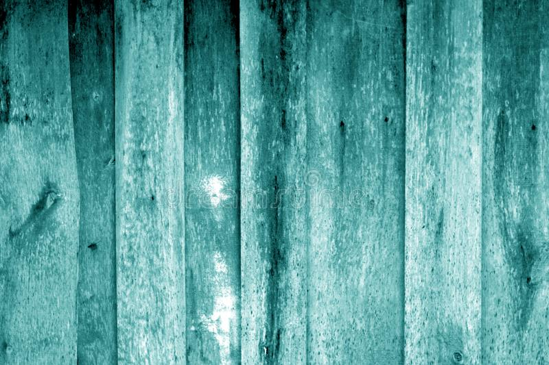 Weathered wooden fence in cyan color. Abstract background and texture for design, blue, green, vintage, old, timber, wall, tree, carpentry, natural, painted stock photo