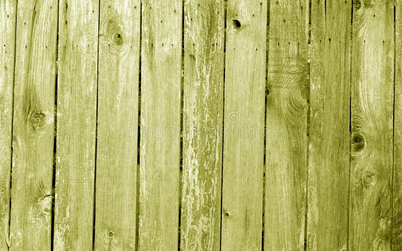 Weathered wooden fence in yellow color. Abstract background and texture for design, vintage, old, timber, wall, tree, carpentry, natural, painted, materials royalty free stock photo