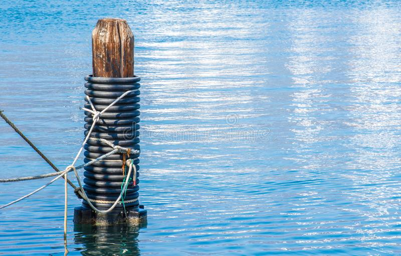 Weathered wooden piling in a California harbor royalty free stock photography