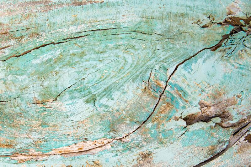 Light green or turquoise wooden plank with fissures royalty free stock photography