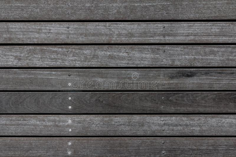 Weathered wooden plank floor texture. Wood pavement background. Abstract home deck pattern royalty free stock image