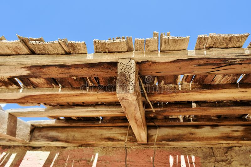 Weathered wooden structure in the desert. Red and brown colors stock photography