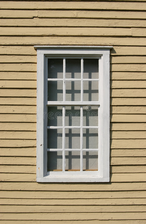 Weathered wooden window. 12 pane's of wooden window that have cracked weathered paint stock photos