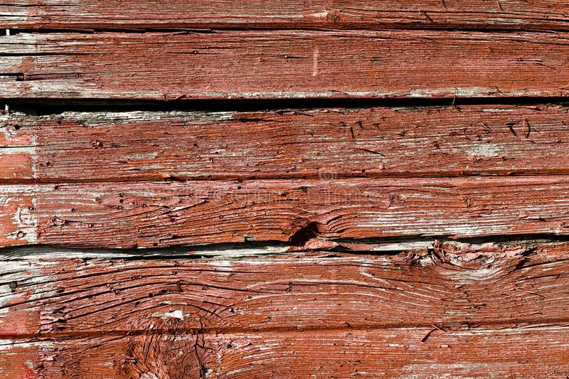 WEATHERED WORN RED BARN WOOD SIDING stock photos