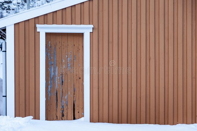 Weathered yellow wooden wall with decay door royalty free stock image