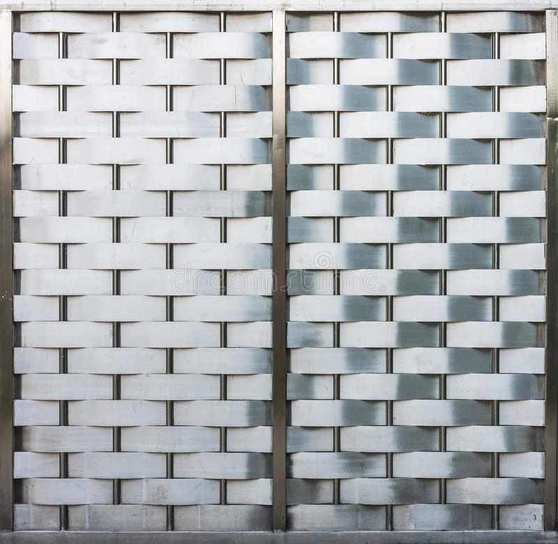 Weave metallic wall with metal frame. It is made of stainless steel royalty free stock photography